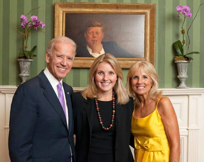 Alicia Molt-West, center, is photographed with President-elect Joseph Biden and Jill Biden.