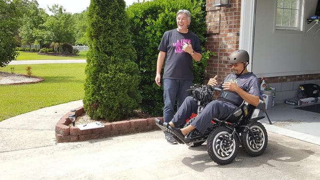Stefan Sandberg of Zoomability Inc. delivers a Zoom mobility chair to retired Command Sgt. Maj. Willie Cain. Cain will have to return the chair and other assets after being found guilty of defrauding the Department of Veterans Affairs of almost $1 million.
