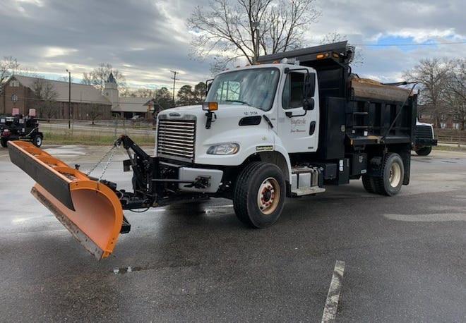 Fayetteville officials say four trucks like this one are ready to spread sand on city streets if snow makes the roads slick.