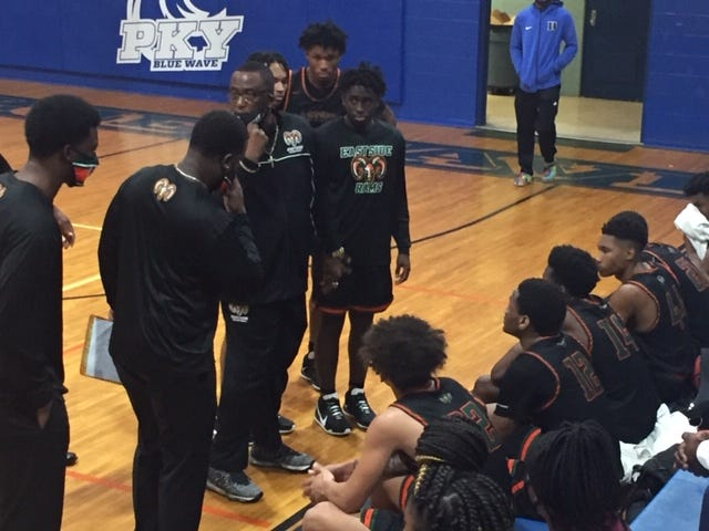 Eastside High School boys basketball coach Pop Williams talks to the Rams during a timeout Thursday at P.K. Yonge.