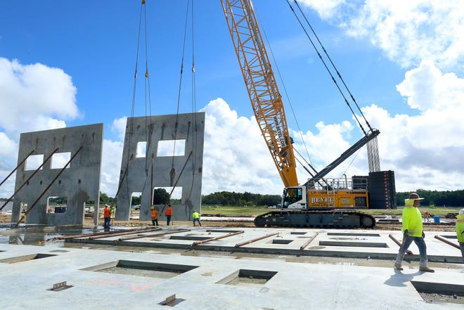 A two-story concrete wall at Elementary School I is worked into place in early September.