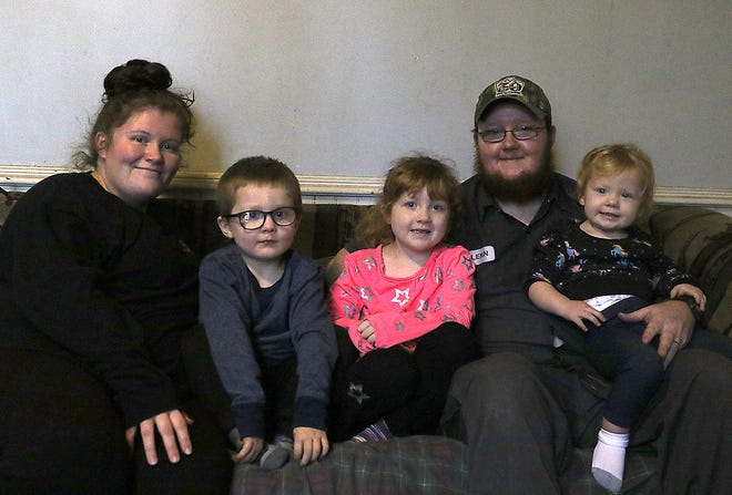 Jessica and Glenn Clarke are shown with their children (left to right) Rowan, 4, Emma, 5, and Sara, 2.