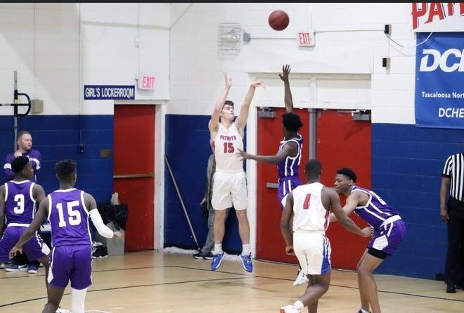 American Christian Academy's Hudson Thrasher (15) shoots in a recent game. Thrasher, the son of former Alabama basketball player Blake Thrasher, scored his 1,000th career point in a game against Hillcrest.