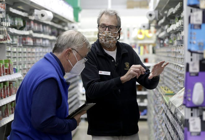 Sales associate Scott Hieatt helps David Foster of Upper Arlington search for hardware supplies Jan. 7, 2021, at Nutter Hardware & Rental in the Kingsdale Shopping Center. According to Emma Speight, the city's community-affairs director, three of the 30 tenant spaces are vacant at the center.