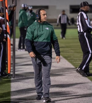 Waxahachie head football coach Todd Alexander patrols the sideline during a District 11-6A game at DeSoto on Oct. 23. Alexander announced Thursday he is stepping down as head coach, but will remain in WISD in a teaching capacity. A search for a new head coach will begin immediately. Alexander coached the Indians to their first-ever Class 6A playoff berth this past season.