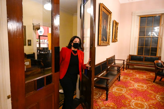 Salem Mayor Kim Driscoll walks into the City Council Chamber inside Salem City Hall to present her annual state of the city address virtually on Thursday, Jan. 7, 2021.