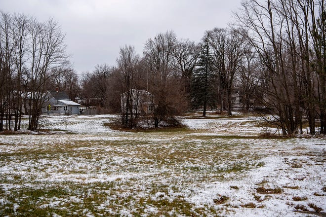 Snow lightly covers the grass on a lot where a 55-unit housing community will be built for those experiencing or at-risk of homelessness on Friday, Jan. 8, 2021 at 535 W Van Buren Street in Battle Creek, Mich