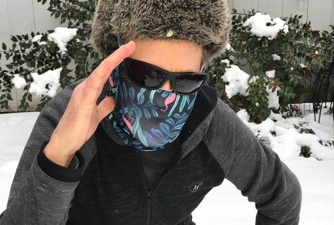 Burlington Free Press reporter Joel Banner Baird adjusts his winter-safety gear — including UV-blocking sunglasses — on Jan. 8, 2021.