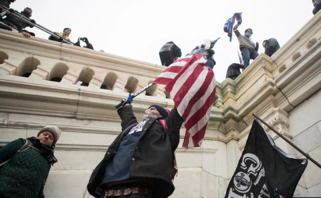 Trump rioters storm the U.S. Capitol Wednesday afternoon as lawmakers inside debated the certification of the presidential election.