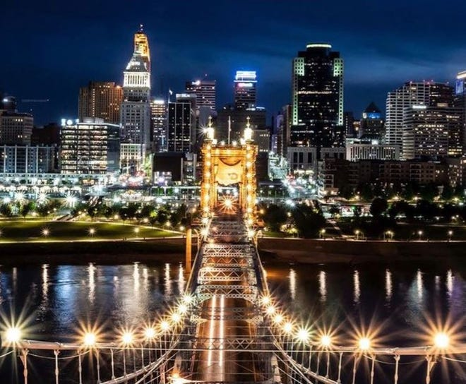 Isaac Wright image of the Cincinnati skyline at night from the John A. Roebling Suspension Bridge.