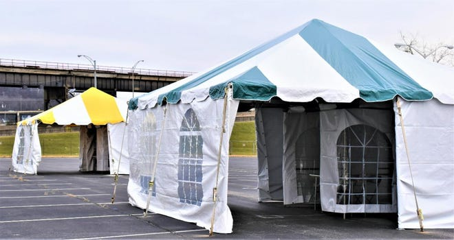Covington has set up tents in a former IRS parking lot to enable federal COVID-19 drive-thru testing to start Monday, Jan. 11.