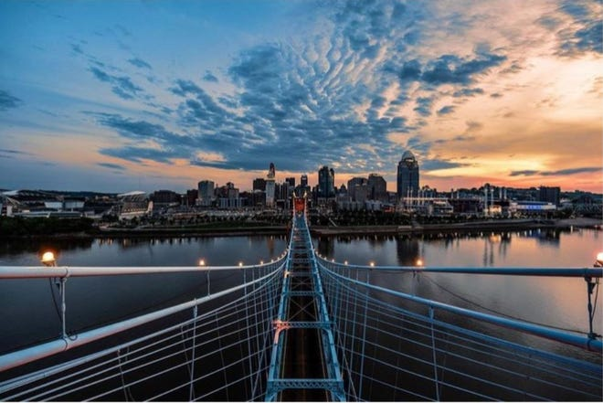 Isaac Wright image of the Cincinnati morning skyline from the top of the John A. Roebling Suspension Bridge.