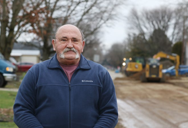Seen with village water line improvements behind him, Oren Griffith, president of the local Chamber of Commerce, considers West Lafayette the best place in America.