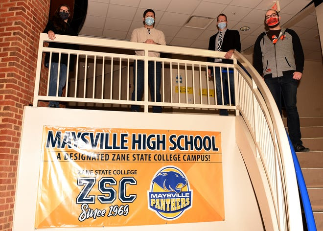 Staff of Maysville High School with a banner designating the school as an alternative campus for Zane State College, which includes the school offering College Credit Plus classes. Pictured are Kris Geis, Lance McGee, Kurt Dreier and John Beach. Not pictured are Ed Geis and Katie Brown.