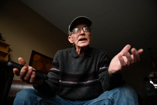 Dave George, 71, sits in his Southgate condo on Friday. George, who suffers from COPD, said he's frustrated after trying and failing to get information on where he can get the COVID-19 vaccination.