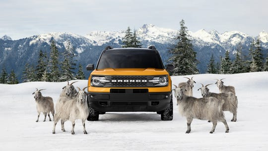 """A shot from Ford Motor Co.'s new ad campaign for the all-new Bronco Sport, emphasizing the vehicle's seven-terrain """"G.O.A.T."""" modes."""