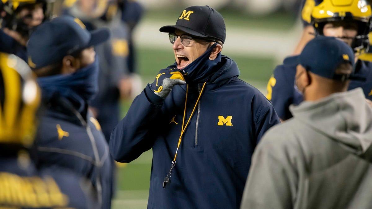 Michigan football coach Jim Harbaugh signs five-year contract 1