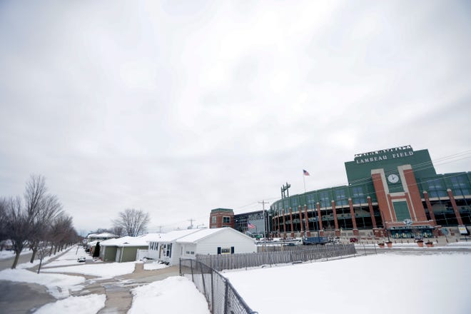 Homes and Airbnb rentals near Lambeau Field that are normally bustling with activity on game days will be relatively subdued on Saturday, when only about 10 percent of the stadium's seats will  be filled.