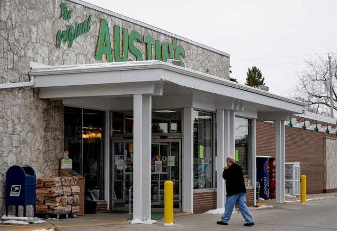 A customer walks into the Original Austin's Grocery Store on Friday in Allouez. The Austin family has run the grocery store  for 67 years and on Jan. 23. the ownership will be transferred to a buyer who also owns a store in Wausaukee and Black Creek.
