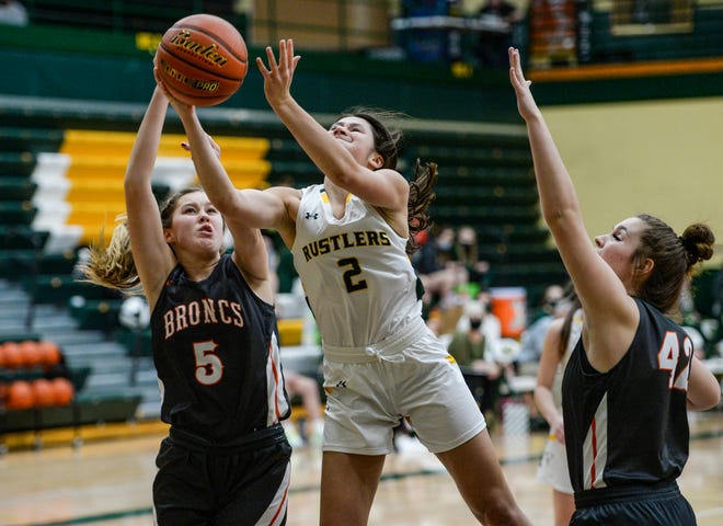 CMR's Lauren Lindseth shoots as Billings Senior's Brenna Linse and Lily Johnson defend in Thursday's basketball game in the CMR Fieldhouse.