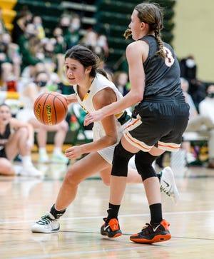 CMR's Lauren Lindseth drives to the basket past Billings Senior's Lauren Cummings in an early season game.