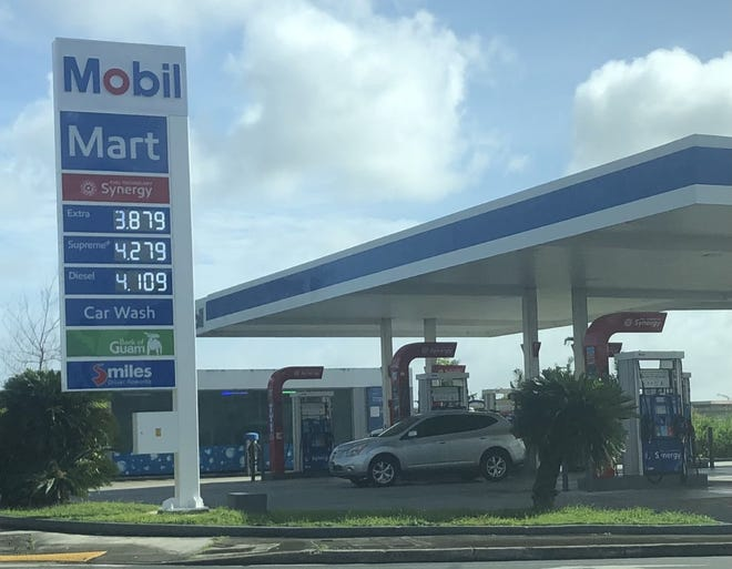 The sign at the Sinajana Mobil gas station reflects a 10-cent jump in the price of a regular gallon of gas on Jan. 8.