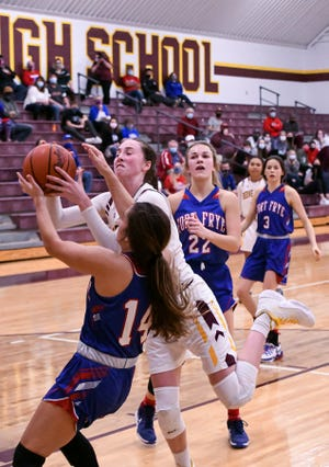 Fort Frye's Riley Medley and Berne Union's Sophia Kline fight for control of the ball Thursday night at BUHS. The visiting Fort Frye Cadets prevailed 41-38.
