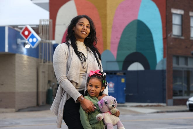 Kiersten Williams and her daughter Namarah Kaye Lee, 5, have been able to utilize the community and therapy resources provided by ACE Awareness Foundation. The foundation will close, but parent services will stay in Memphis. In the background, a mural painted by Williams.