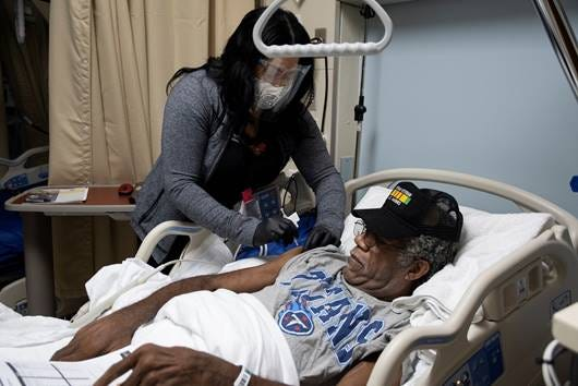U.S. Marine Corps veteran Randy L. Johnson, Sr., who served in Vietnam, receives his first dose of the COVID-19 vaccine at the Memphis Veterans Affairs Medical Center on Dec. 22, 2020. Johnson was the first patient at the VA to receive the vaccine.