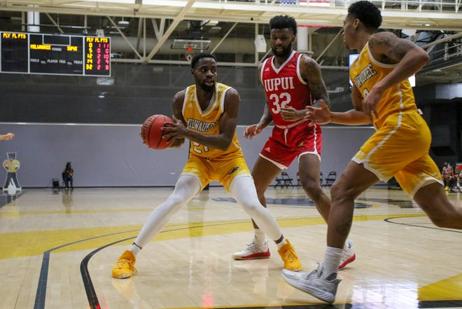 UWM's Tafari Simms, left, shown in a previous game, the Panthers with 24 points and Te'Jon Lucas, right, had 16 Saturday.