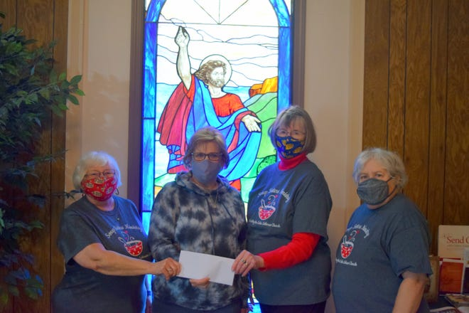 The Soup Sisters Ministry recently donated $1,000 to the Marion County Senior Center to help fund a new food-delivery truck. Shown above are  (from left) Soup Sister Anna Mattson; Chris Jenkins, MCSC manager; and Soup Sisters Linda Masters and Sherri Mosier.