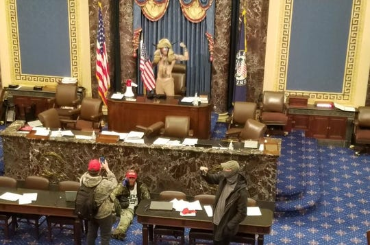 "Jacob Anthony Chansley, aka ""Jake Angeli"" aka the ""QAnon Shaman,"" at the front of the Senate in the U.S. Capitol Jan. 6."