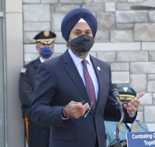 NJ Attorney General Gurbir Grewal talks to guests as he and NJ Governor Phil Murphy visited a Morris County Vaccination Mega-Site, in an empty Sears store at the Rockaway Mall on January 8,2021, highlighting the beginning of the vaccination effort for law enforcement and fire professionals.