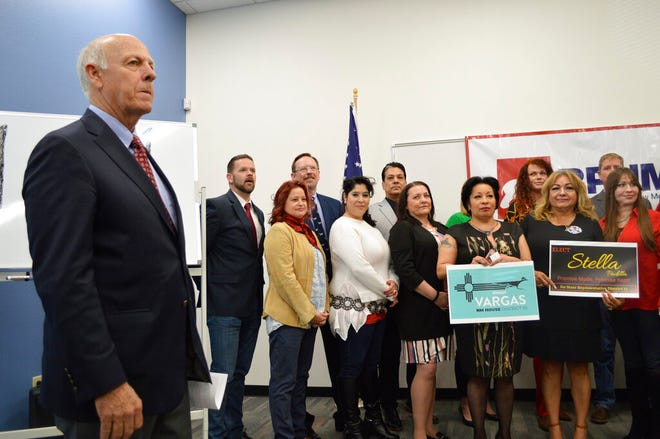 Republican Party of New Mexico chairman Steve Pearce, left, stands alongside GOP candidates for the state House and Senate on Wednesday, March 11, 2020, at a press conference in Albuquerque, N.M.
