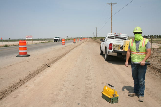 A New Mexico Department of Transportation worker checks on traffic on a stretch of United States Highway 285.