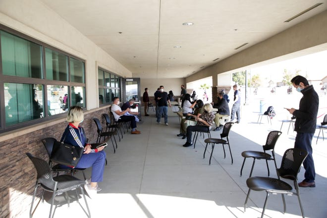 Recipients of the Moderna COVID-19 vaccine wait outside at Roy Wilson Training Center in Thousand Palms, Calif.  on Thursday, January 7, 2021. Recipients of the vaccine waited 15 minutes outside after receiving the shot in order to monitor any possible reactions.