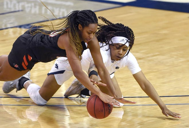 Nevada's Lexie Givens and San Diego State's Ivvana Murillo chase a loose ball in the second half of the Thursday's game at  Lawlor Events Center. Nevada lost 59-43.