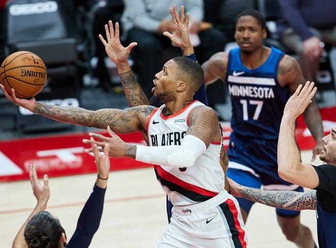 Portland Trail Blazers guard Damian Lillard (0) shoots over Minnesota Timberwolves forward Juancho Hernangomez (41) during the second quarter at the Moda Center.