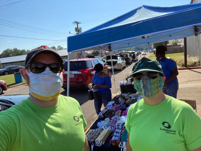 Mike Mitchell and Jeri Winkleback smiling behind their masks at Sustainable Tallahassee's September mask give-away.