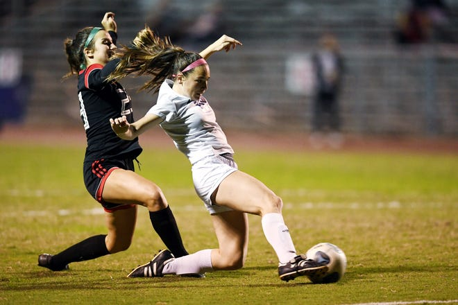 Martin County High School's Emma Johnson tries to put the ball in the net through the defense of Vero Beach's Rachel Talley on Thursday, Jan. 7, 2020, during a game at the Citrus Bowl in Vero Beach. Martin County won the match 1-0.