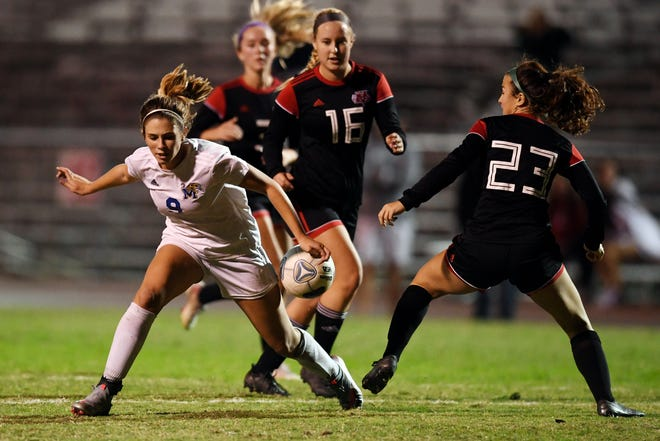 Martin County's Peyton Fitzherbert battles Vero Beach defenders for the ball on Thursday, Jan. 7, 2020 during a girls soccer match at the Citrus Bowl in Vero Beach. Martin County won the match 1-0.