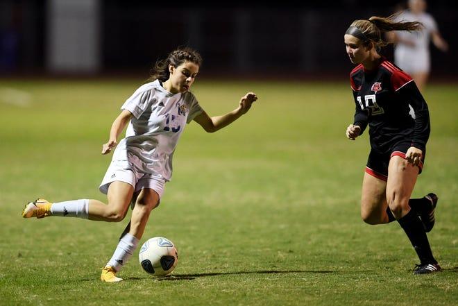 Martin County's Mia Calderon (15) controls the ball during a match earlier this season.