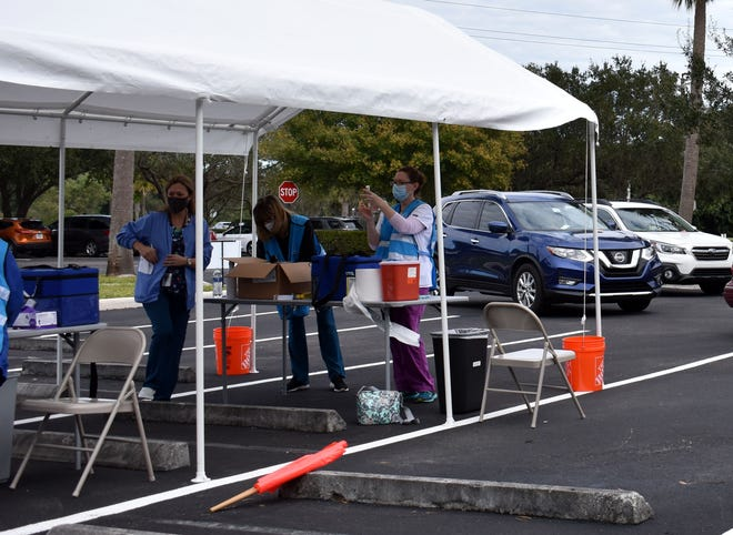 Medical staff prepare to administer the Moderna COVID-19 vaccine Monday, Jan. 4, 2021, at a drive-thru clinic held by the Florida Department of Health's Martin County office in Stuart.