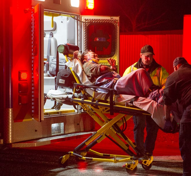 Wichita Falls emergency medics worked to transport the reported driver of a truck that struck a utility pole to a hospital for treatment to his injuries.