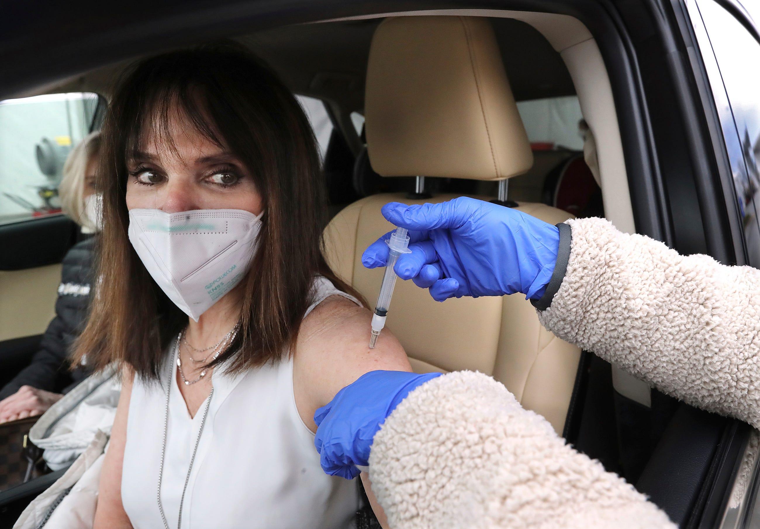 Coronavirus updates: Virus claims member of famed Tuskegee Airmen; Queen Elizabeth gets vaccinated