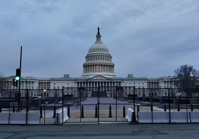 New black metal fence surrounds most of the U.S. Capitol building in Washington, D.C., two days after pro-Trump supporters stormed the Capitol. Friday, Jan. 8, 2021