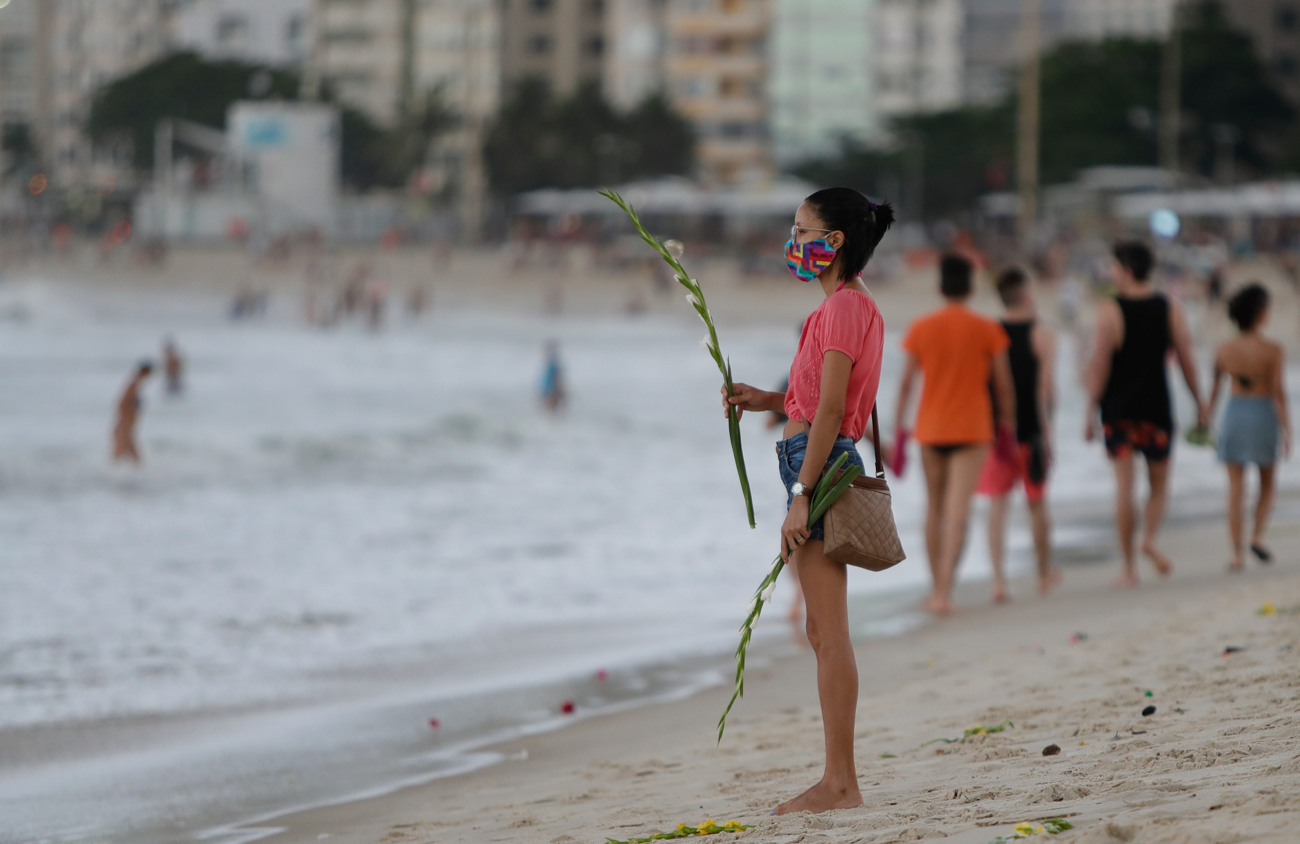 Brazilian beaches packed over holidays even as COVID death toll neared 200,000