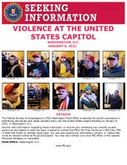 "Handout poster from the Federal Bureau of InvestigationÕs (FBI) Washington Field Office ""seeking the publicÕs assistance in identifying individuals who made unlawful entry into the United States Capitol Building on January 6, 2021, in Washington, D.C."""