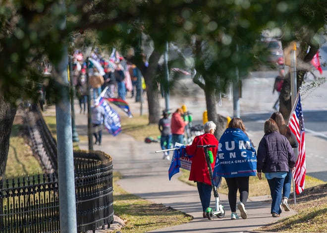 Supporters of then-President Donald Trump make their way to the eastside grounds of the Texas State Capitol for a rally on Jan. 9. [AMERICAN-STATESMAN/FILE]