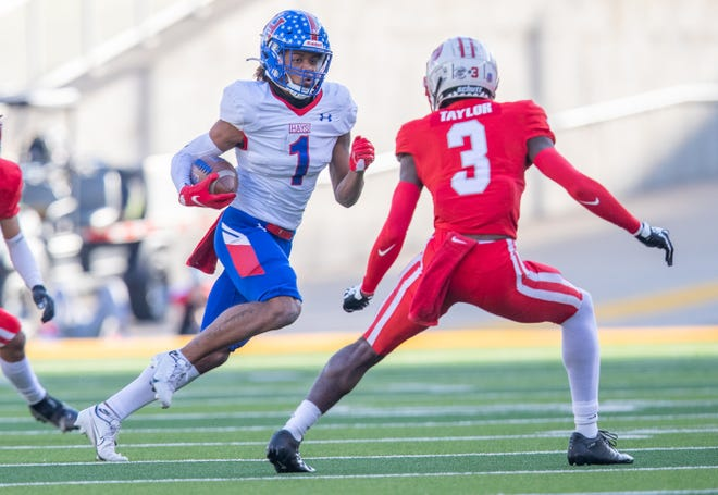 Hays wide receiver Bryant Lewis tries to evade the tackle by Katy defensive back Bobby Taylor during the Rebels' 63-7 loss Saturday in a Class 6A Division II semifinal game at McClane Stadium in Waco.